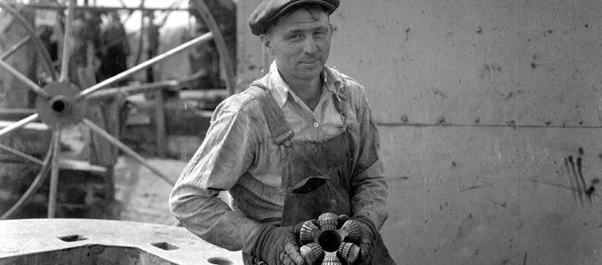 Roughneck-holding-a-1920's-era-drill-bit