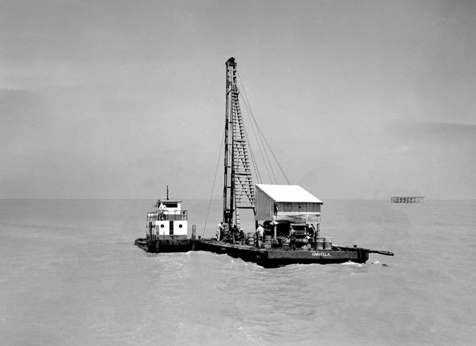 Harvey La. Barge getting ready to drive a few pilings… 1950's