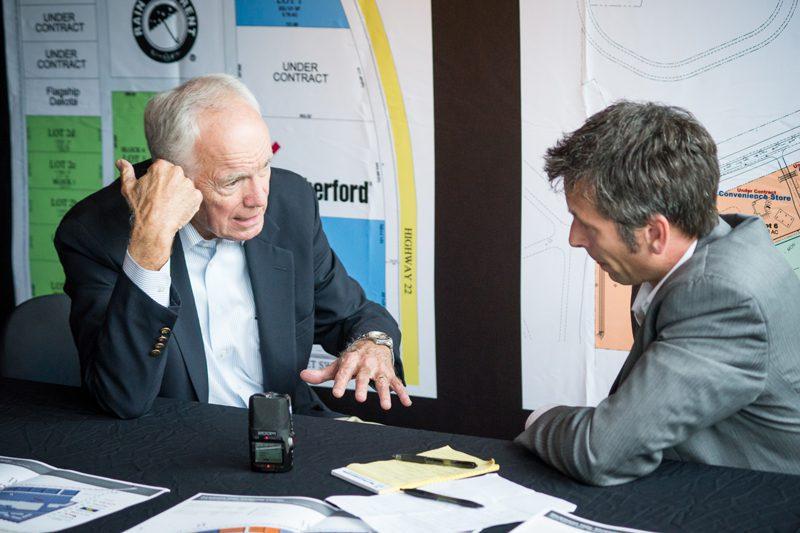 Loren Scott, president, Loren Scott & Associates and professor, Louisiana State talks with Jason Spiess (right).