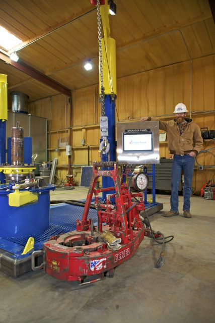 Dearl Berrier standing next to the tong test stand