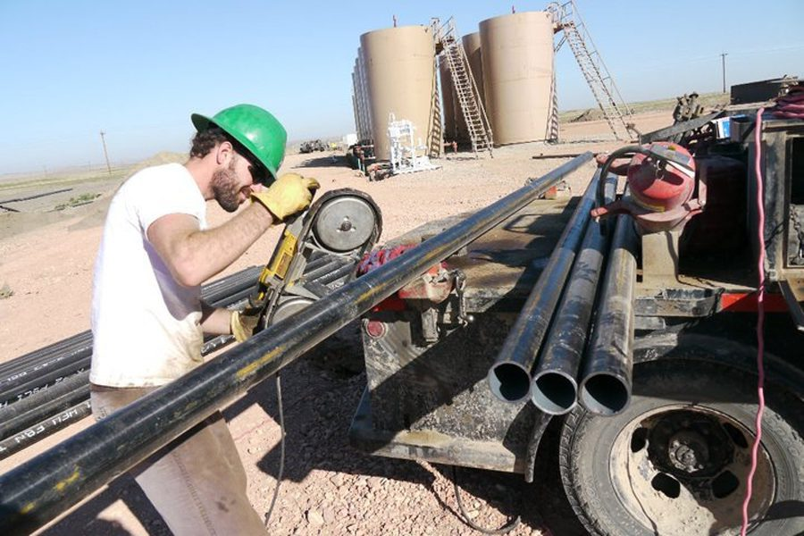 """Filmmaker and producer Nathan Anderson works a well site doing research for his upcoming movie about family life in the oil fields.  Anderson's previous film was titled """"Last Summer for Boys.""""  No release date or final movie title was available at deadline."""