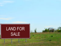 51129706 - land for sale sign in empty field