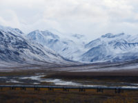 52746859 - oil pipeline with mountain in northern alaska