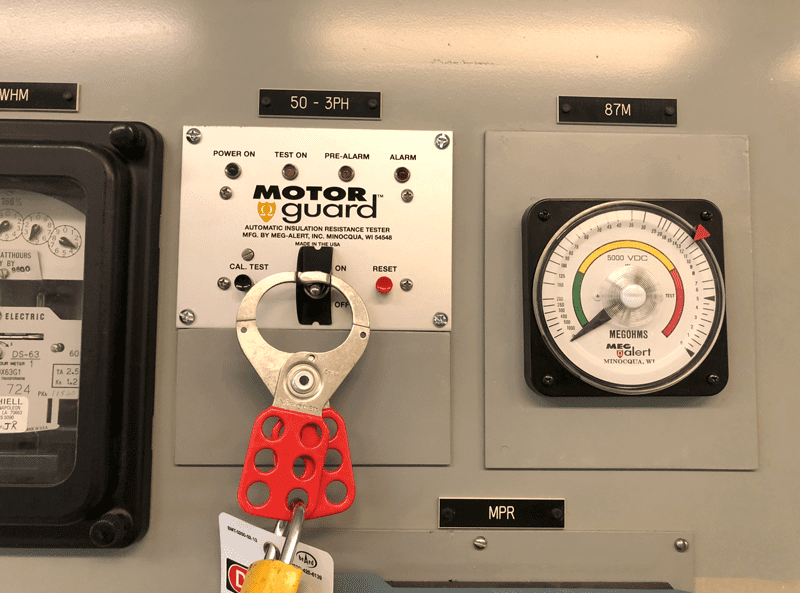 The Meg-Alert Model GP5000-MU-AS (ARC SAFE) remote LED/switch panel with on/off switch LOTO bracket and analog megohm meter.