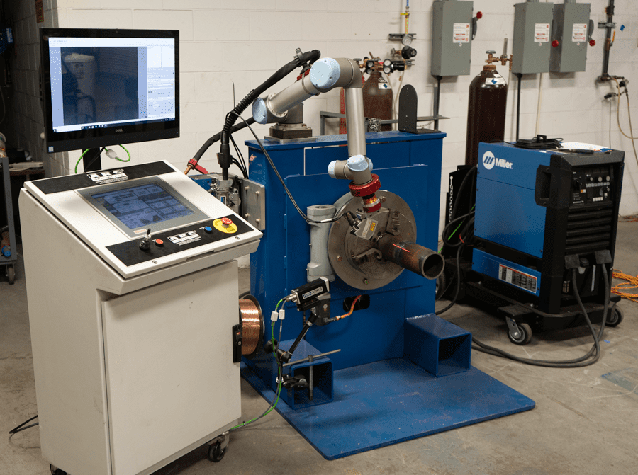 The Artificial Intelligence Pipe Welding (AIPW) system from ARC Specialties combines a Micro-Epsilon laser scanner, artificial intelligence software and a Universal Robots six-axis UR5 robot arm.