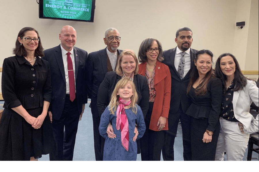 Katie Mehnert, center, and her daughter pose with members of the Energy Subcommittee of the House Committee on Energy and Commerce. Photo courtesy of Katie Mehnert