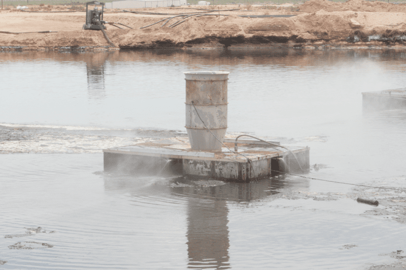 2.0 units float on the surface of the evaporation pond, allowing concentrated droplets to fall back into the water.
