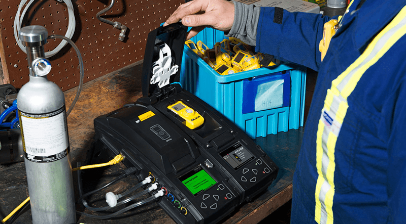 A docking station is used to automatically calibrate gas monitors and update calibration records.