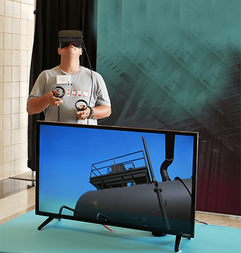 A Danos employee participates in training via a virtual, interactive platform with a qualified assessor. The VR platform intertwines with iCAN's competency and learning software to perform regression analytics, allowing the company to enhance employee development through individualized training.