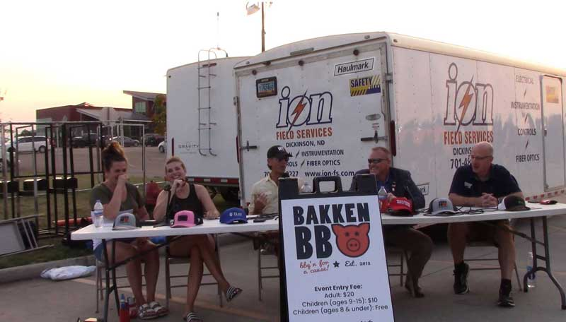 "Living the Crude Life live recording session at the Bakken BBQ in Dickinson, ND. Host Jason Spiess (middle) moderates the discussion of ""How Oil and Gas Builds Culture and Communities"" with the co-founders of the Bakken BBQ, Jackie Jenkin (left) and Tiffany Steiner (middle left); Mayor of Bismarck (ND) Steve Bakken (middle right), and Patrick Bertagnoli, community enhancement director, City of Watford City (right)."