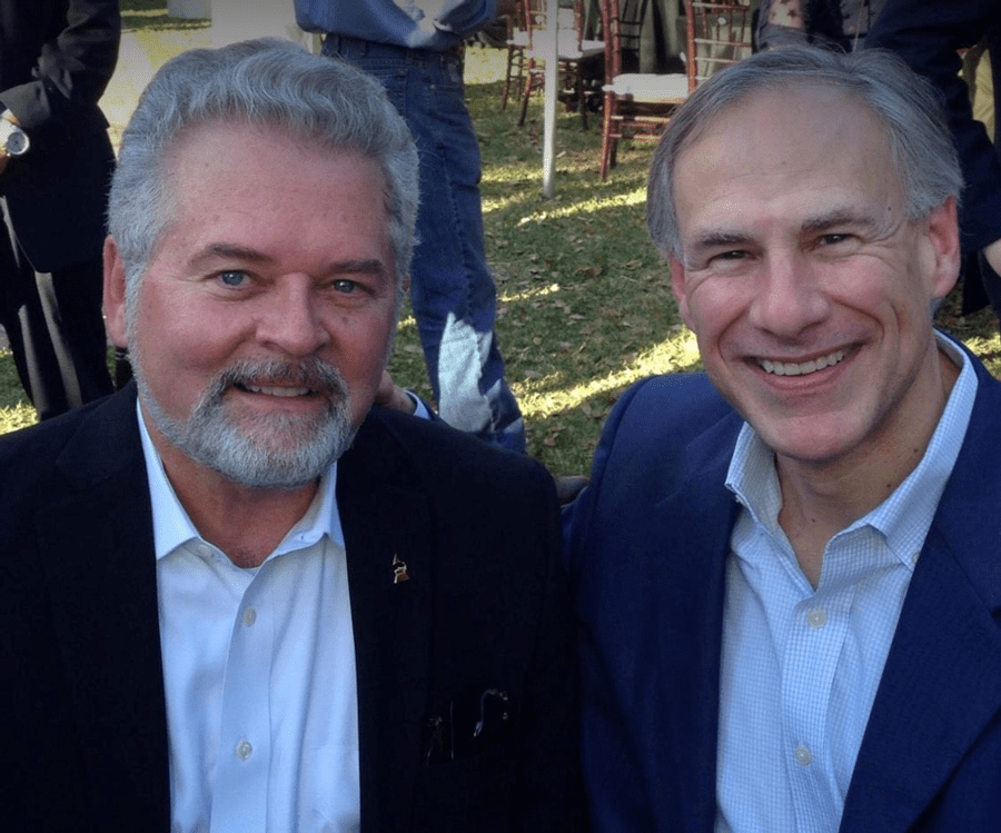 Mark Stansberry (L) and Texas Governor Greg Abbott (R) talk energy.